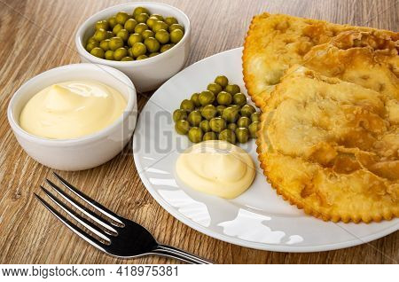 Bowls With Green Peas And Mayonnaise, White Plate With Two Fried Cheburek, Green Peas And Mayonnaise
