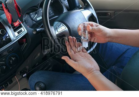 Cropped Image Of Man Using Small Portable Sanitizer To Cleaning His Hands Inside Of Car