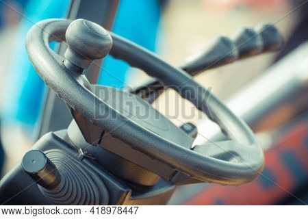 Steering Wheel And Operating Control Levers In Forklift, Tractor, Excavator Or Other Agricultural An