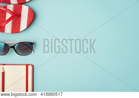 Top View Photo Of Striped Flip-flops Sunglass And Red Planner With Pencil On Isolated Pastel Blue Ba