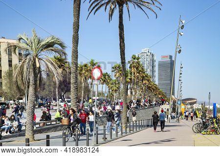 Spain, Barcelona, March, 2021: People Walking On Barceloneta Is A Neighborhood In The Ciutat Vella D