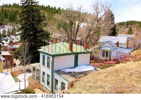 Homes Surrounded By A Temperate Forest Taken On A Mountainous Plateau At The Former Mining Town Of C