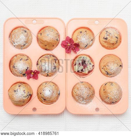 Fresh Baked Muffins Or Cupcakes In Pink Silicone Baking Tins, Top View