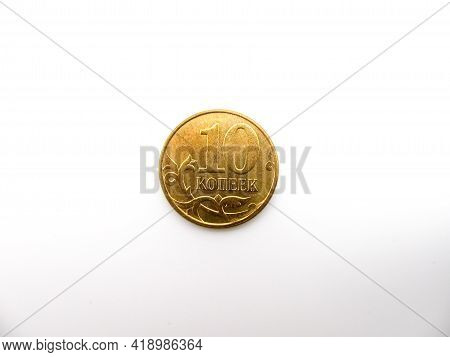 Russian Ten Kopeck Coin On A White Background. The Currency Is The Ruble.