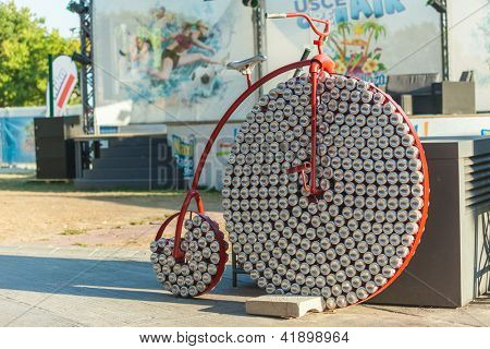 BELGRADE, SERBIA - AUGUST 15: Penny farthing made from coca cola cans on August 15, 2012 in Belgrade, Serbia. Shopping malls organise outdoor activities to attract families in summer.