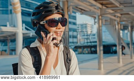 Asian Businesswoman With Backpack Call Mobile Phone Talk Smiling In City Street Go To Work At Office