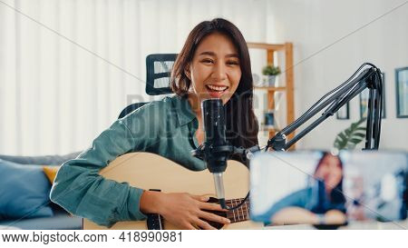 Teenage Asia Girl Influencer Play Guitar Music Use Microphone Record With Smartphone For Online Audi
