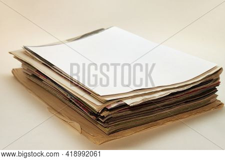 Neat Stack Of Newspapers And Magazines. Shallow Depth Of Field