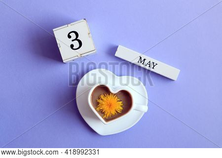 Calendar For May 3 : A Cube With The Number 3, The Name Of The Month Of May In English, A Cup Of Cof