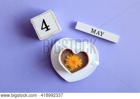 Calendar For May 4: A Cube With The Number 4, The Name Of The Month Of May In English, A Cup Of Coff