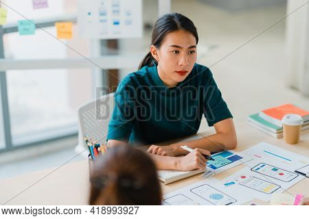 Asian Businessmen And Businesswomen Meeting Brainstorming Ideas About Creative Web Design Planning A
