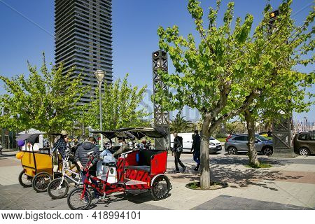 Spain, Barcelona, March, 2021: Rickshaw Taxis Group Waiting For Tourists Near Port Olimpic In Barcel