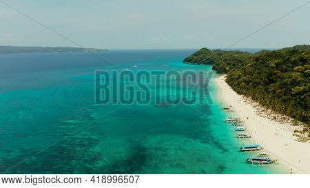 Aerial Seascape: Tropical Beach With Palm Trees And Turquoise Waters Of The Coral Reef, From Above,