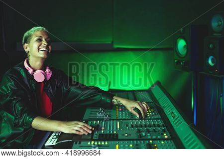 Young Woman Working In Music Recording Studio - Female Audio Engineer Mixing A Sound In Production H