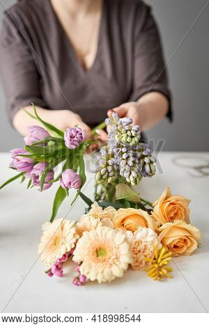 Unpacking Flowers Bunch, Set For Home. Fresh Cut Flowers For Decoration Home. European Floral Shop.