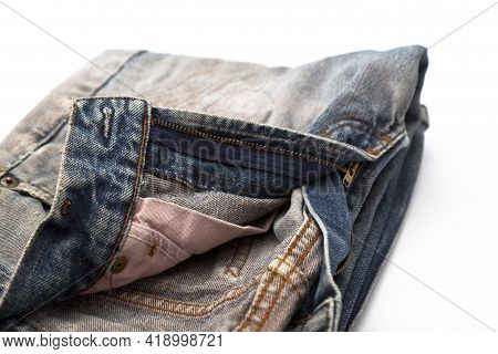 Blue Denim Jeans With Yellow Stitching. Close-up Of A Fashionable Jean And Belt.