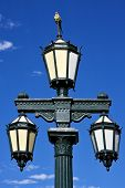 old green street lamp parrot and clouds in buenos aires argentina poster