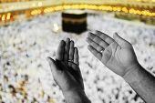 Muslim Arabic man praying at Kaaba in Mecca poster