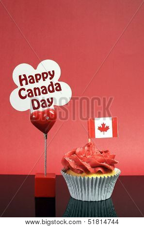 Red and white theme Canadian cupcake with maple leaf flag and sign with Happy Canada Day Vive Le Canada or copy space for your text here. Vertical with copy space for your text here. poster