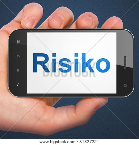 Finance concept: hand holding smartphone with word Risiko(german) on display. Generic mobile smart phone in hand on Dark Blue background. poster