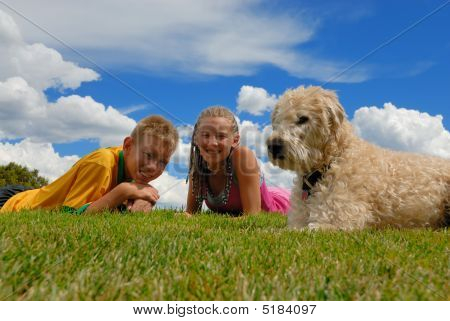 Siblings With Their Dog