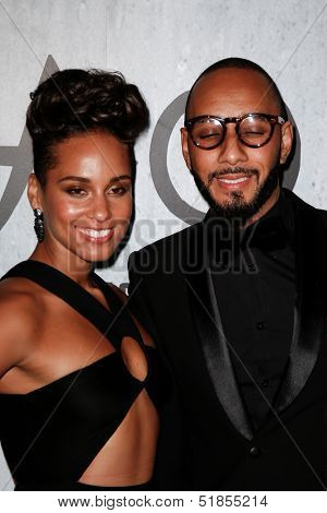 NEW YORK-SEP 28: Recording artist Alicia Keys and husband Swizz Beatz attend the grand opening of TAO Downtown at the Maritime Hotel on September 28, 2013 in New York City.