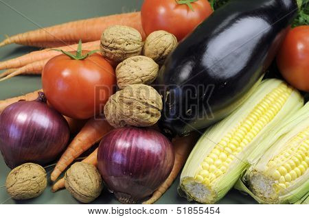 Fresh Raw Food Including Eggplant, Mulnuts Nuts Carrots Tomotoes And Corn For Healthy Diet Concept O