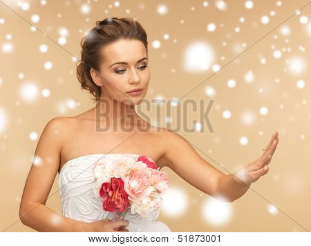 valentine's day, bridal, wedding, christmas, x-mas, winter, happiness concept - bride looking at wedding ring
