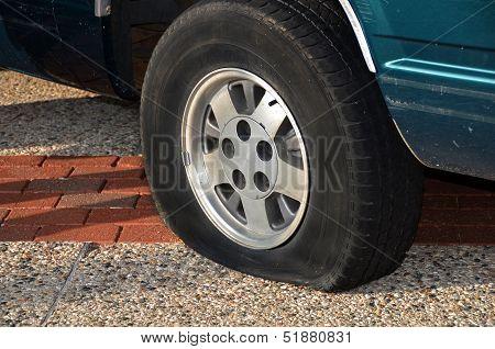 flat tire on automobile