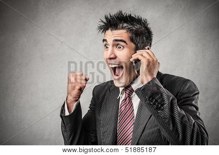 happy businessman receives good news on the phone