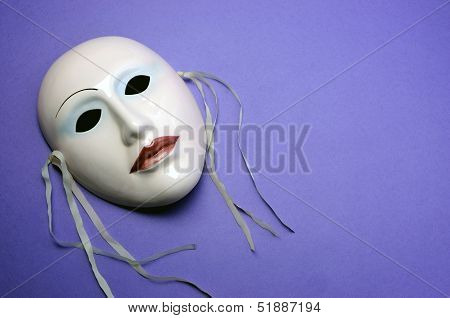 Pale Pink Ceramic Mask On Purple Background For Actor, Performance Or Theatre Concept With Copy Spac