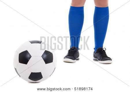 Legs Of Soccer Player In Blue Gaiters With Ball Isolated On White