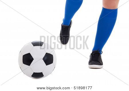 Leg Of Soccer Player In Blue Gaiters Kicking Ball Isolated On White