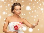 valentine's day, bridal, wedding, christmas, x-mas, winter, happiness concept - bride looking at wedding ring poster