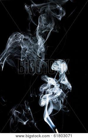Mystic Smoke shows white smoke with black background. poster