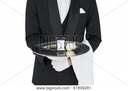 Mid section of server presenting engagement ring and rose isolated over white background