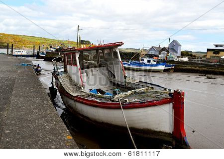 Tied boat in Wexford Harbor in Ireland poster
