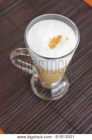 Coffee Latte With Frothy Milk In Tall Glass.