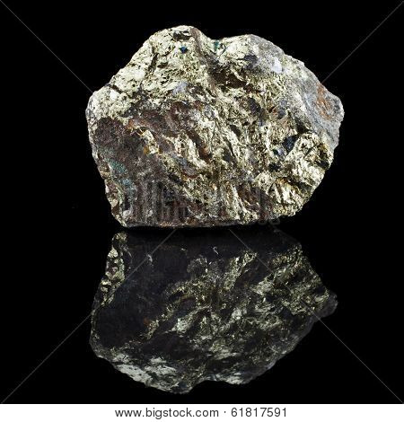 Chalkopyrite copper with reflection on black surface background
