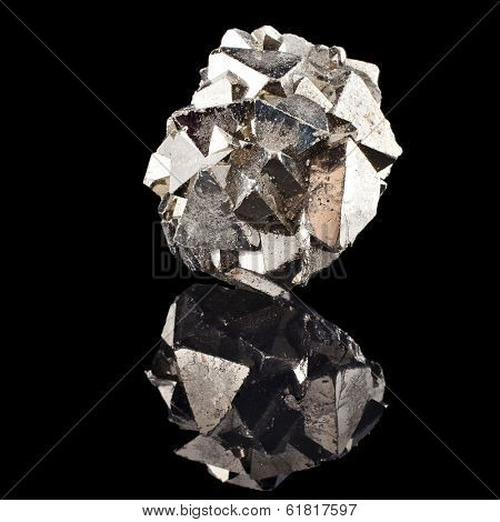 Pyrite with reflection on black surface background