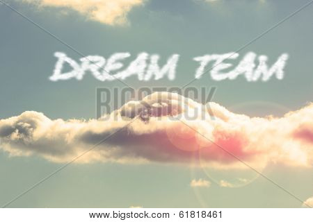 The word dream team against bright blue sky with cloud poster