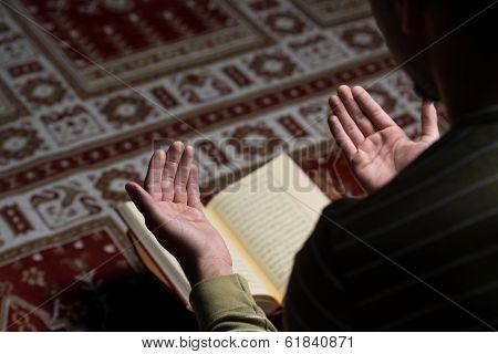 Muslim Man Is Reading The Koran