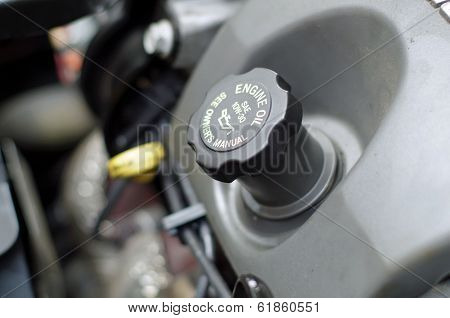 Engine Oil Cap with Dip stick in Background