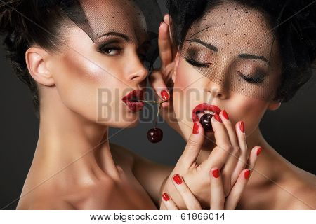 Love. Temptation. Pair Of Sexy Women Eating Cherry Berries