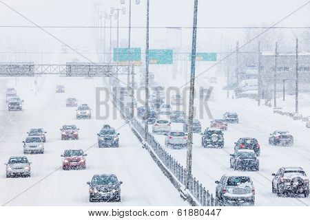 Snowstorm On The Highway During The Rush Hour
