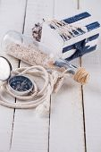 Marine items on wooden background. Sea objects on wooden planks. Selective focus. poster