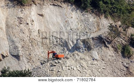 Excavator Building The Road On A Steep Slope