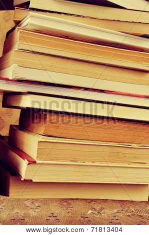 closeup of a piles of books, with a retro effect