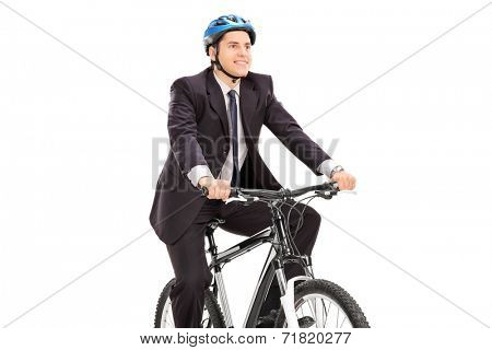Young businessman riding a bicycle isolated on white background