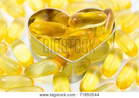 Fish Oil Pills On Heart Shape Box Isolated